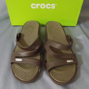 Brown Crocs with low heel.